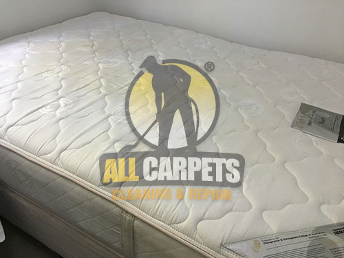 Clean a dirty white mattress using steam before and after in Melbourne