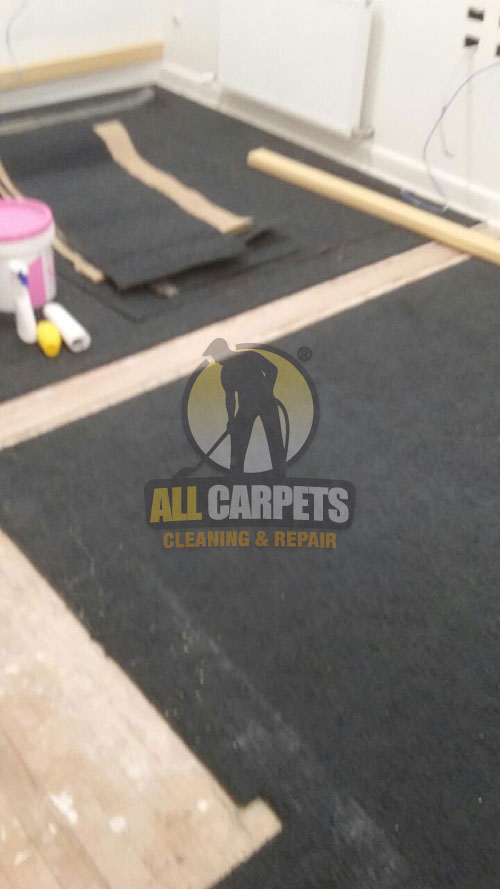 before and after repairng a black carpet in Perth