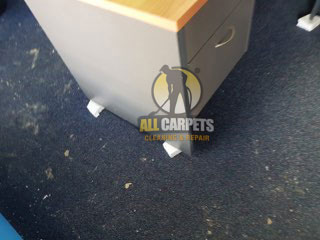 before repair a black carpet in